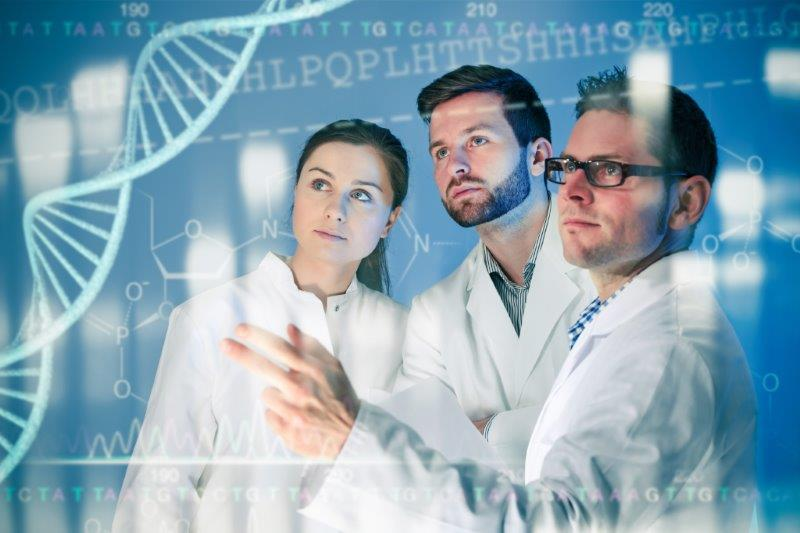 Geneticists with dna structure on glass board